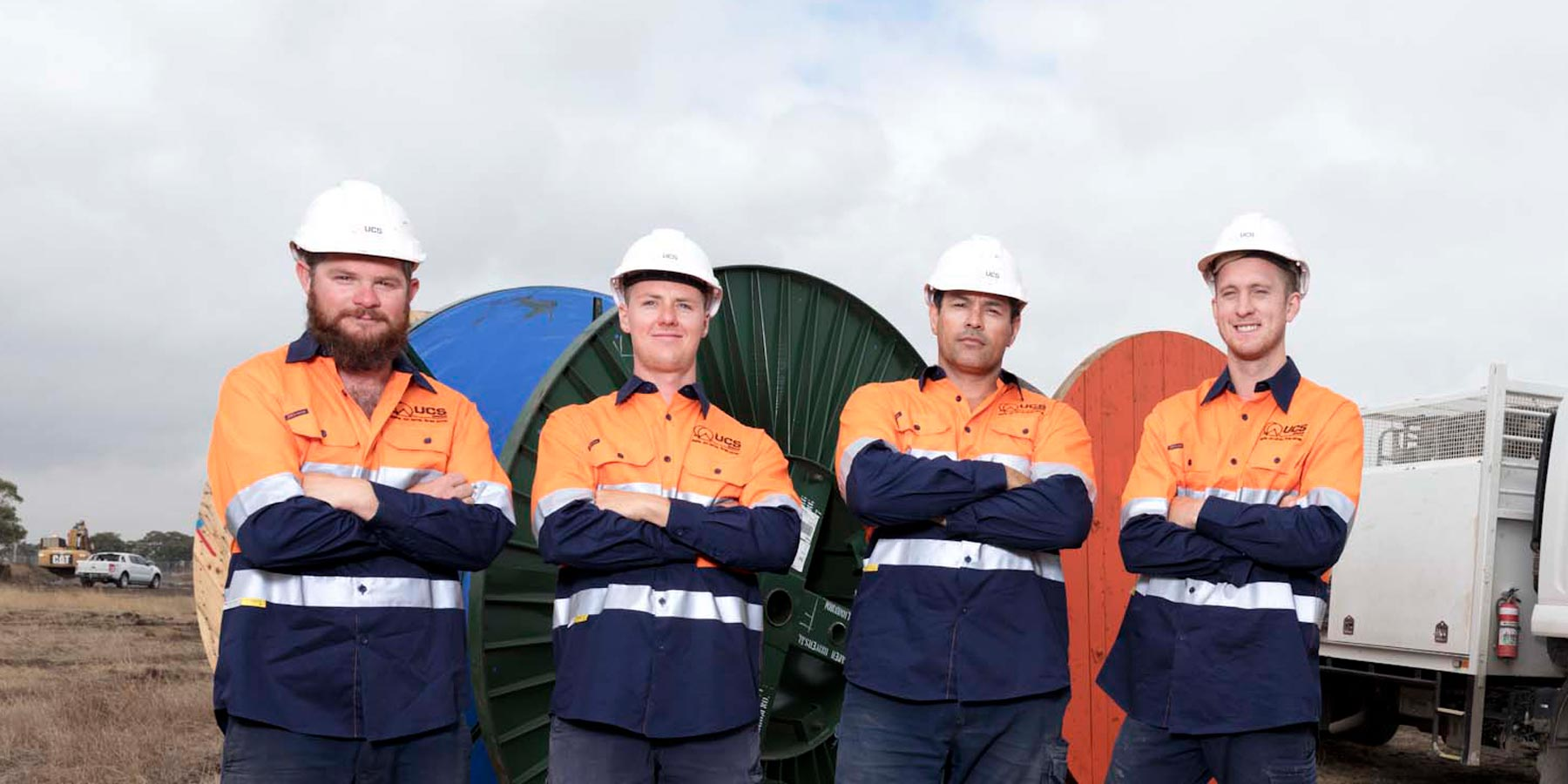 Four proud UCS workmen